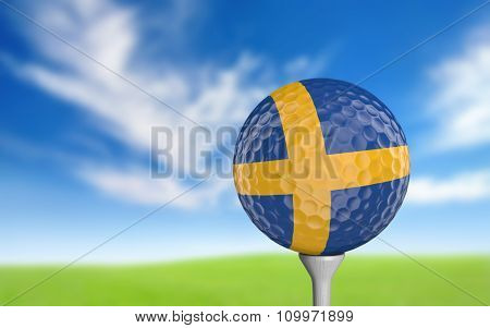 Golf ball with Sweden flag colors sitting on a tee