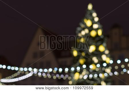 Abstract Blurred Background Of Decorated New Year Fir In Urban Space