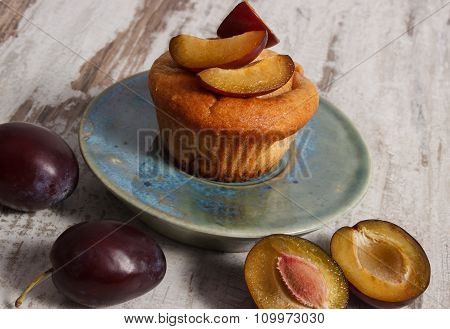 Fresh Baked Muffins With Plums On Plate On Old Wooden Background, Delicious Dessert