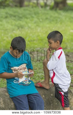 Boys Enjoy Playing Games On The Smart Phone