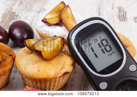 Glucometer And Muffins With Plums On Wooden Background, Diabetes And Delicious Dessert