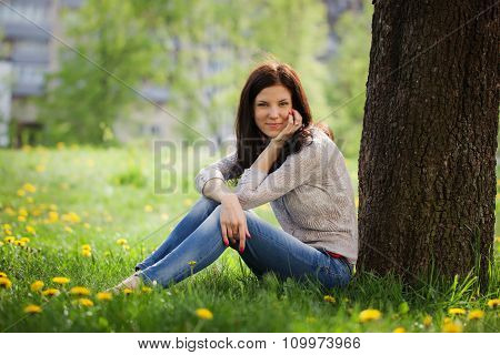 Young Beautiful Woman , On Green Background Summer Nature.