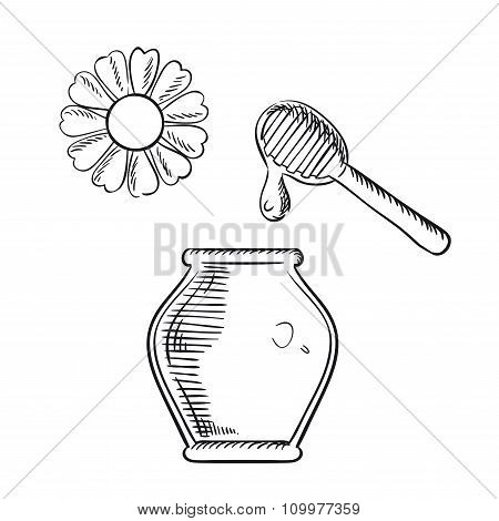Honey jar with dipper and flower