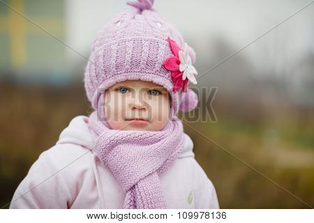 Beautiful Smiling Little Girl In Pink Coat Close Up