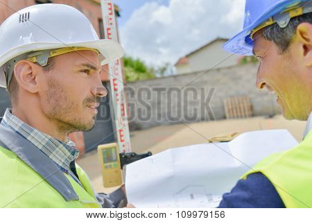 Two builders looking at plans