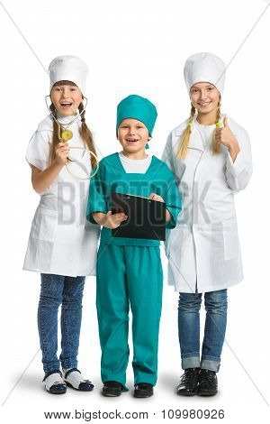 Cute little children dressed like doctor looking at camera with  cheerful smile isolated on white ba