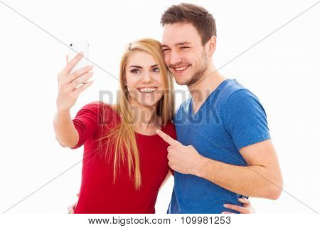 Young beautiful couple isolated on white background
