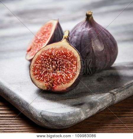 Delicious fresh figs on a marble board
