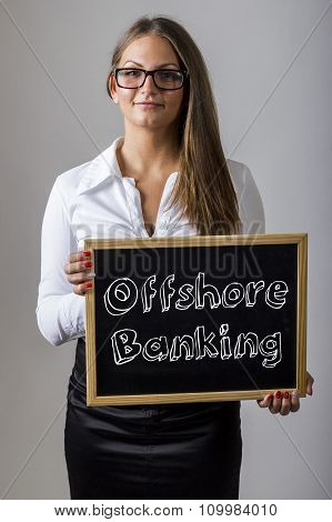 Offshore Banking - Young Businesswoman Holding Chalkboard With Text