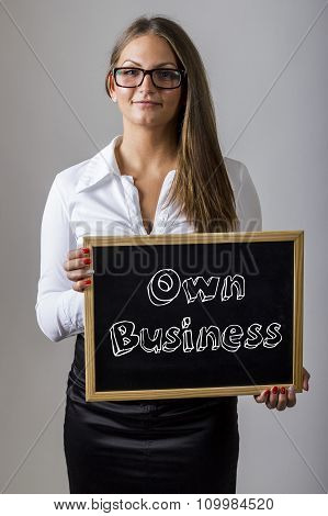 Own Business - Young Businesswoman Holding Chalkboard With Text