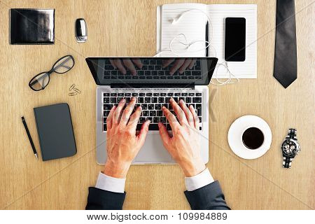 Man Hands With Laptop, Diary, Coffee Mug, Watches And Other Accessories On Wooden Table, Mock Up