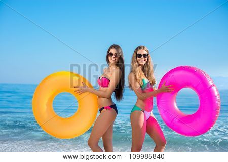 Girls with rubber rings at the resort.