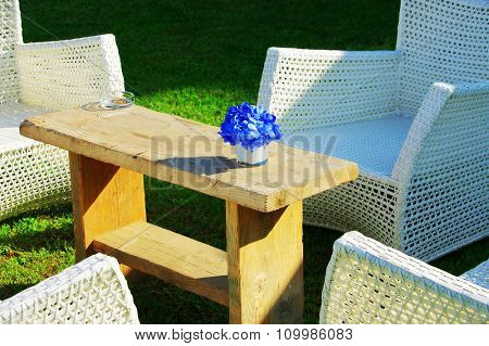 White furniture and flowers in the garden