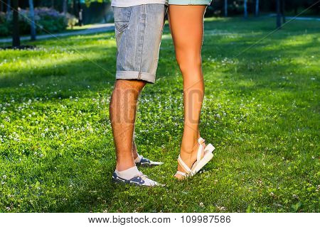 Legs of guy and girl.