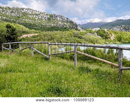 Mountain Landscape With Wooden Fence And Lake