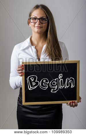 Begin - Young Businesswoman Holding Chalkboard With Text