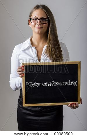 Videoconferencing - Young Businesswoman Holding Chalkboard With Text