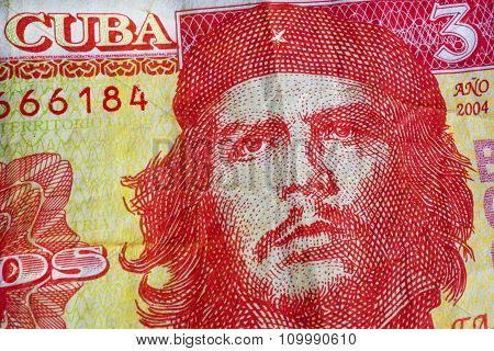 Che Guevara On Yellow Red Banknotes Of Cuba Bank. Texture Of Old Note Of The Official Cuban Currency