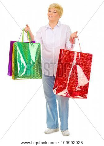 Happy senior woman with bags isolated