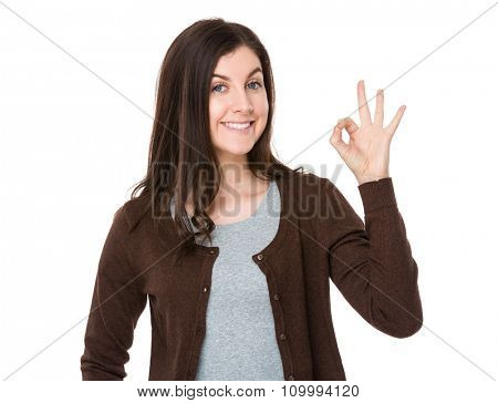 Young woman with ok sign gesture