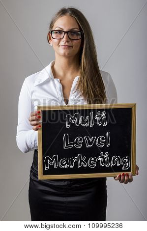 Multi Level Marketing Mlm -  Young Businesswoman Holding Chalkboard With Text