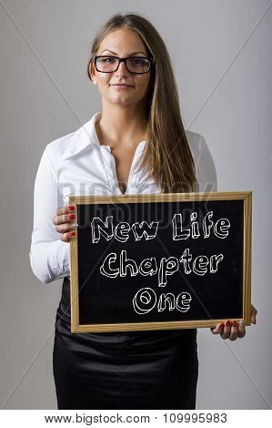 New Life Chapter One - Young Businesswoman Holding Chalkboard With Text