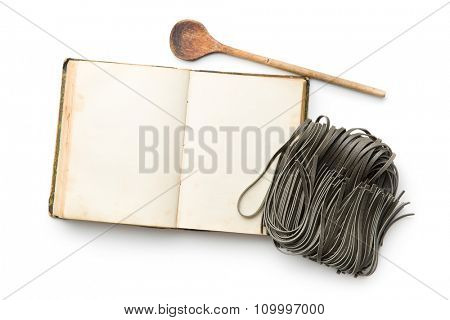 cookbook and black noodles with squid sepia ink on white background