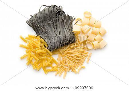 various pasta on white background