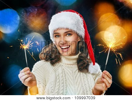 Happy new year! Beautiful woman holding sparkles.