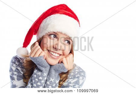Cute girl with toothy smile wearing Santa cap