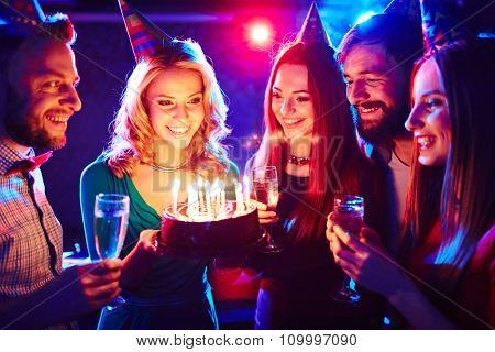 Happy young friends enjoying birthday party
