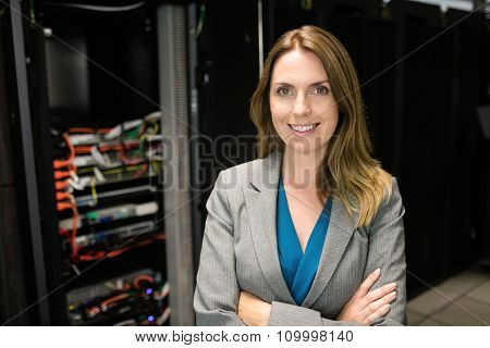Confident technician looking at camera at the data centre