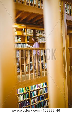 Mature student in the library at the university