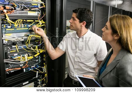 Team of technicians working together at the data centre