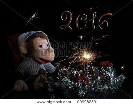 Toy monkey Christmas wreath and sparkler