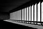 Постер, плакат: Tunnel with columns in black and white photo abstract tunnel photo black and white photo architec