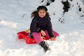 pic of toboggan  - Girl with toboggan in the snow at winter time - JPG