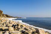 Постер, плакат: Sea stones on the beach of winter