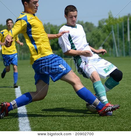 KAPOSVAR, HUNGARY - JUNE 11: Balazs Szili (in white) in action at the Hungarian National Championship under 13 game between Kaposvari Rakoczi FC and Bajai LSE June 11, 2011 in Kaposvar, Hungary.