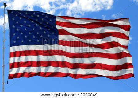 American Flag In Bright Blue Sky