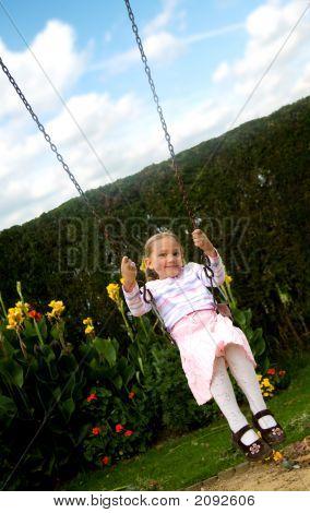 Happy Girl On A Swing