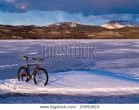 Bike on frozen Lake Laberge, Yukon, Canada