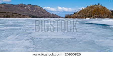Skiing on Frozen Lake Laberge, Yukon, Canada