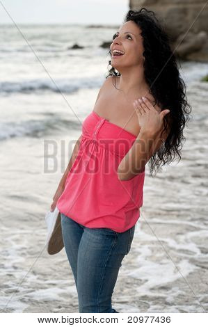 Young Girl Walking In The Ocean