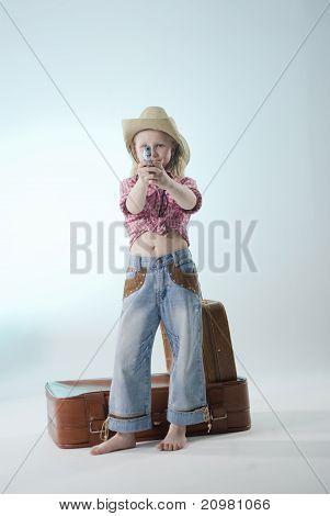 Cowgirl aiming a gun