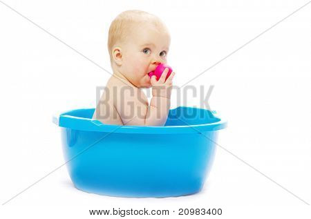 baby sitting in a blue tub