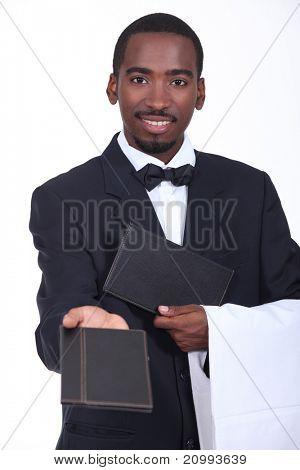 Waiter offering a menu