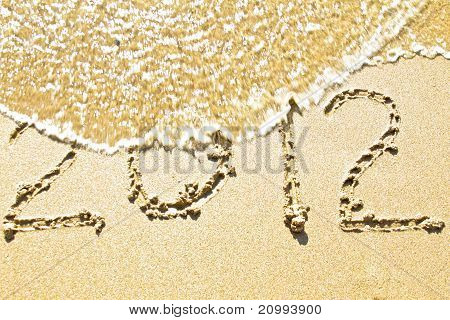 The welcome of the new year 2012; message in the sand at the beach near the ocean