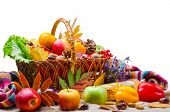 Vegetables And Fruit In A Wicker Basket, Isolated On White. poster