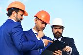 Board Of Architects With Concerned Faces In Suits And Helmets poster